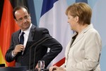 German Chancellor Merkel and French President Hollande address a news conference after their talks in the Chancellery in Berlin